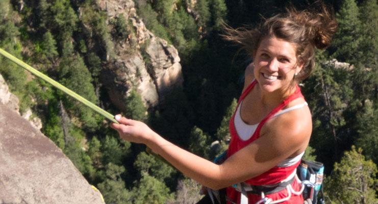 woman posing while rock climbing