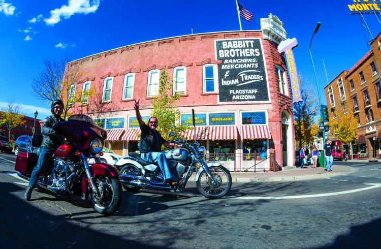 two bikers riding through downtown flagstaff