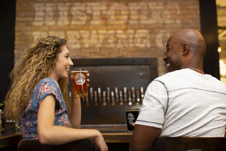 man and woman drinking beer